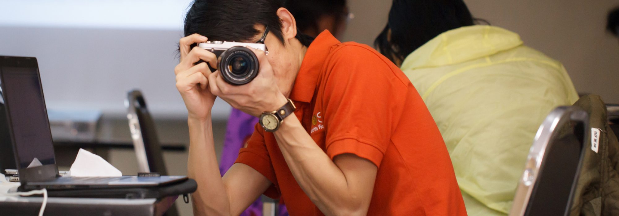 Opel Tannumsaeng takes a picture during a communications workshop in Bangkok Thailand.