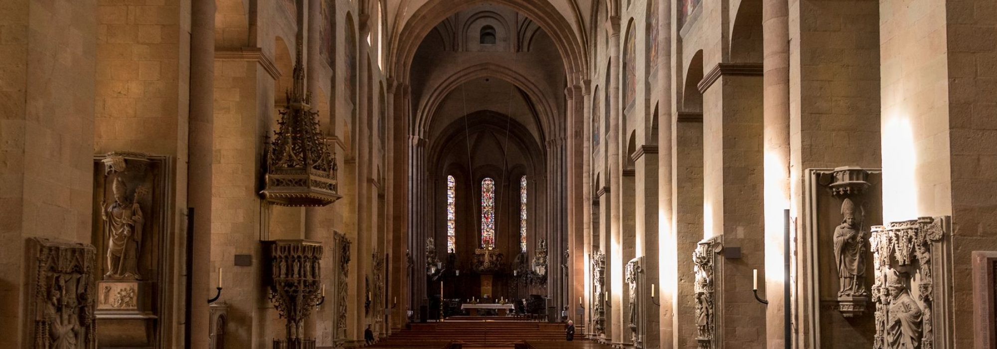 Midday sunlight illuminates the maine nave of Saint Martin's Cathedral in Mainz, or the Mainzer Dom. One of Mainz's most well-known buildings, it has stood over 1,000 years.
